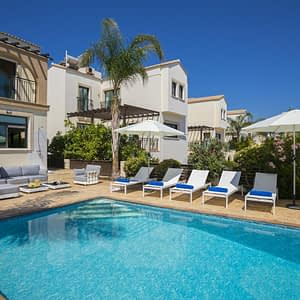 Image is showcasing the outdoor area of Mylos Villa in Protaras, along with the pool area of the villa.